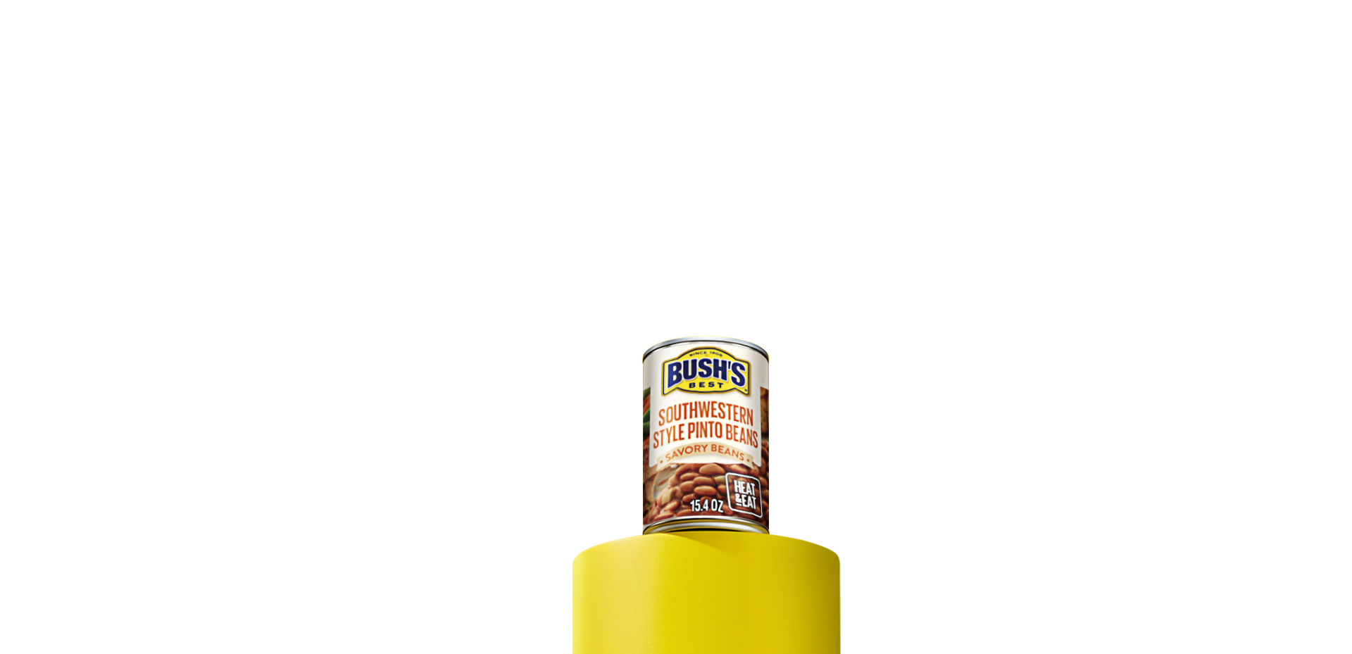 A can of Bush's Best Savory Beans Southwestern Style Pinto beans sitting on a yellow column