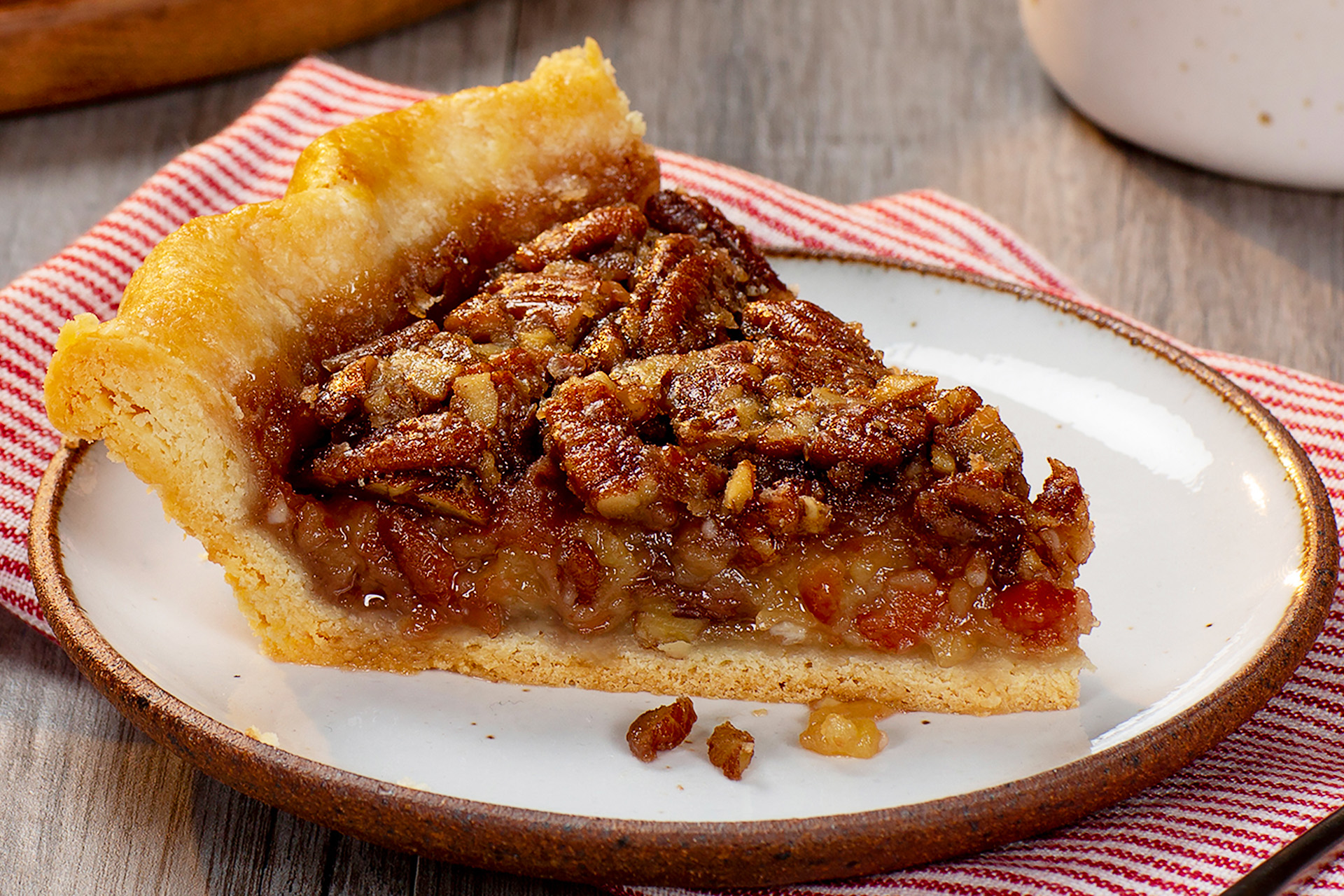 One piece of pinto bean pecan pie on a white plate